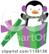 Cartoon Of A Cute Penguin Popping Out Of A Christmas Gift Box Royalty Free Vector Clipart
