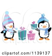Cartoon Of Cute Christmas Penguins With Gift Boxes Royalty Free Vector Clipart