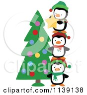 Cartoon Of Cute Christmas Penguins Stacking To Put A Star On A Tree Royalty Free Vector Clipart