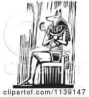 Clipart Of A Black And White Egyptian Anubis Sitting Woodcut Royalty Free Vector Illustration