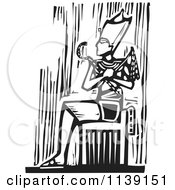 Clipart Of A Black And White Egyptian Pharaoh Sitting Woodcut Royalty Free Vector Illustration