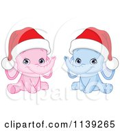Cartoon Of Cute Pink And Blue Baby Elephants Wearing Santa Hats Royalty Free Vector Clipart by yayayoyo