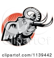 Clipart Of A Retro Angry Elephant Over A Circle With Rays Royalty Free Vector Illustration