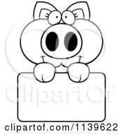 Cartoon Clipart Of A Black And White Piglet Holding A Sign Vector Outlined Coloring Page