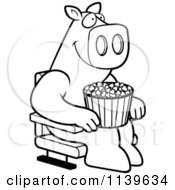 Cartoon Clipart Of A Black And White Happy Pig With Popcorn At The Movie Theater Vector Outlined Coloring Page