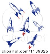 Clipart Of Retro Blue Space Shuttle Rockets Royalty Free Vector Illustration