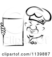 Clipart Of A Black And White Asian Chef Holding A Menu Royalty Free Vector Illustration