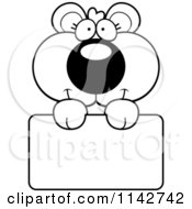 Cartoon Clipart Of A Black And White Cute Bear Cub Holding A Sign Vector Outlined Coloring Page