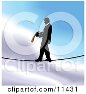 Businessman Walking On A Tightrope Clipart Illustration