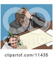 Stressed Businessman Doing Paperwork At A Desk