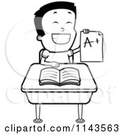 Cartoon Clipart Of A Black And White Smart School Boy Sitting At A Desk With An A Plus Report Card Vector Outlined Coloring Page