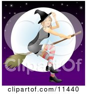 Young Witch Flying On A Broomstick In Front Of The Moon Clipart Illustration