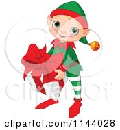 Cartoon Of A Cute Christmas Elf Boy Carrying A Big Present Royalty Free Vector Clipart by Pushkin