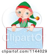 Cartoon Of A Cute Christmas Elf Boy Pointing Down At A Snow Sign Royalty Free Vector Clipart by Pushkin