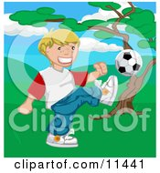 Happy Blond Boy Kicking A Soccer Ball