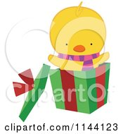 Cartoon Of A Cute Christmas Duckling Or Chick In A Gift Box Royalty Free Vector Clipart