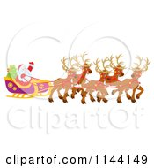 Cartoon Of Santa Waving From His Sleigh While Holding The Reins To His Reindeer Royalty Free Clipart