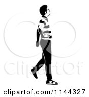 Clipart Of A Black And White Young Man Walking And Looking 2 Royalty Free Vector Illustration