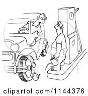 Cartoon Of A Black And White Man With Flat Tires At A Gas Station Royalty Free Vector Clipart