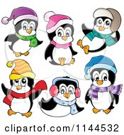Cartoon Of Cute Little Penguins Wearing Scarves Winter Hats And Ear Muffs Royalty Free Vector Clipart