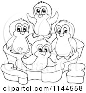 Cartoon Of Cute Black And White Penguins On An Ice Berg Royalty Free Vector Clipart by visekart