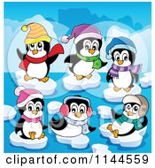 Cartoon Of Cute Penguins With Winter Accessories Playing On Ice Bergs Royalty Free Vector Clipart
