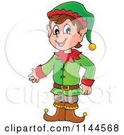 Cartoon Of A Happy Male Christmas Elf Presenting Royalty Free Vector Clipart by visekart