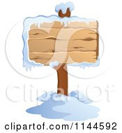 Cartoon Of A Wooden Winter Sign Post With Snow Royalty Free Vector Clipart by visekart