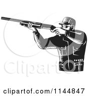 Clipart Of A Retro Black And White Hunter Holding A Rifle 2 Royalty Free Vector Illustration