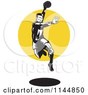 Clipart Of A Retro Woodcut Handball Player Jumping Over A Circle Royalty Free Vector Illustration by patrimonio