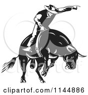 Clipart Of A Retro Black And White Rodeo Cowboy On A Bucking Bull Royalty Free Vector Illustration