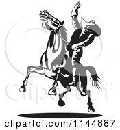 Clipart Of A Retro Black And White Rodeo Cowboy On A Bucking Horse 1 Royalty Free Vector Illustration