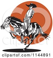 Clipart Of A Retro Rodeo Cowboy On A Bucking Horse 2 Royalty Free Vector Illustration