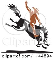Clipart Of A Retro Rodeo Cowboy On A Bucking Horse 1 Royalty Free Vector Illustration