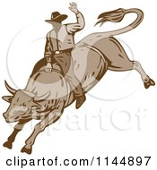 Clipart Of A Retro Rodeo Cowboy On A Bucking Bull 2 Royalty Free Vector Illustration