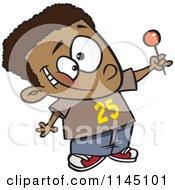 Happy Black Boy Holding Up A Lollipop