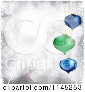 Clipart Of 3d Green And Blue Christmas Baubles Over Silver Bokeh Lights Royalty Free Vector Illustration by elaineitalia