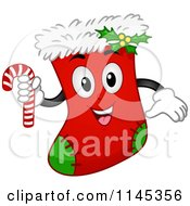 Cartoon Of A Christmas Stocking Mascot Holding A Candy Cane Royalty Free Vector Clipart by BNP Design Studio