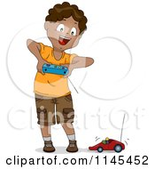 Happy Black Boy Playing With A Remote Controlled Toy Car