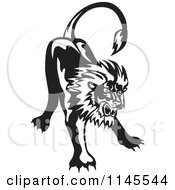 Clipart Of A Retro Black And White Angry Lion Royalty Free Vector Illustration