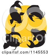 Clipart Of Silhouetted Koi Fish Over A Yellow Circle Royalty Free Vector Illustration