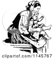 Clipart Of A Retro Vintage Black And White Mother Putting Socks On Her Daughter Royalty Free Vector Illustration