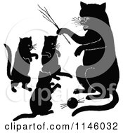 Clipart Of Retro Vintage Silhouetted Cats Playing Royalty Free Vector Illustration