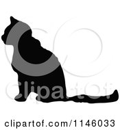 Clipart Of A Retro Vintage Silhouetted Cat In Profile Royalty Free Vector Illustration