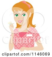 Happy Blond Caregiver Woman In Scrubs Holding A Pill Bottle