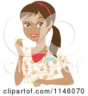 Happy Hispanic Caregiver Woman In Scrubs Holding A Pill Bottle