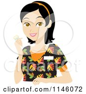 Happy Black Haired Caregiver Woman In Scrubs Holding A Pill Bottle