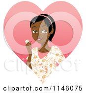 Happy Black Caregiver Woman In Scrubs Holding A Pill Bottle Over A Heart