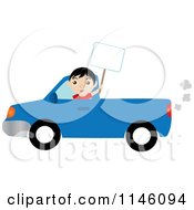 Boy Driving A Blue Pickup Truck And Holding Up A Blank Sign
