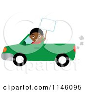 Boy Driving A Green Pickup Truck And Holding A Sign